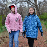 Justin Sheely | The Sheridan Press Fifth-graders Danielle Duenow, left, and Mariah Shippy walk up the path in search for garbage during Coffeen Elementary School's community service projec ...