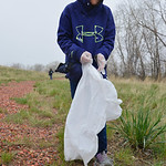 Justin Sheely | The Sheridan Press Fifth-grader Madison Plummer carries a trash bag as she looks for litter during Coffeen Elementary School's community service project day Tuesday at Klee ...