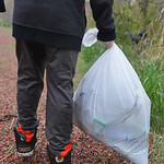 Justin Sheely | The Sheridan Press A student carries a bag of trash during Coffeen Elementary School's community service project day Tuesday at Kleeburn Recreation area near Acme. The fift ...