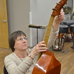 Justin Sheely | The Sheridan Press Sheridan College Viol Consort member Kathy Beagle tunes her viol during practice Tuesday at Sheridan College. The Sheridan College Symphony Orchestra's i ...