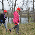 Justin Sheely | The Sheridan Press Fifth-graders Kaitlyn Wagner, left, and Alexis Schoenfelder walk along the embankment in search for garbage during Coffeen Elementary School's community  ...