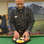 Justin Sheely | The Sheridan Press Richard Snider sets up the rack for a new game during the pool tournament Wednesday morning at the Sheridan Senior Center. The Sheridan Senior Center and t ...