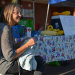 Justin Sheely | The Sheridan Press Shelly Jelly passes time at her booth by crochet work during the weekly Farmers Market Thursday on Grinnell Plaza.