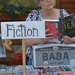 Justin Sheely | The Sheridan Press Sheryl Hanson of Buffalo looks at a book from the Story Branch Library book sale during the 29th Annual Story Days Saturday in Story.