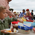 Justin Sheely | The Sheridan Press Kindergartener Hudson Turley loads his plate with a side during the back to school celebration Wednesday at Big Horn Schools. The event provided an opportu ...