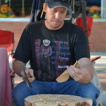 Justin Sheely | The Sheridan Press Jonathan Willson chips away from a piece of wood to make a spoon during the weekly Farmers Market Thursday on Grinnell Plaza. Willson, a full time cabinet  ...