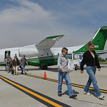 Justin Sheely | The Sheridan Press Cy Magee, left, and Antje Evans walk towards the terminal after flying Fly Sheridan's 1000th flight Saturday at Sheridan County Airport. Passenger air se ...