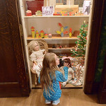 Justin Sheely | The Sheridan Press Nine-year-old Mercedes Kwallek looks at a closet filled with toys during the Holiday Open House at the Trail End State Historic Site Friday evening. Festiv ...