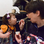 Justin Sheely | The Sheridan Press Jodi Shell spoons some figgy pudding for her daughter Martha Shell, 2, during the Holiday Open House at the Trail End State Historic Site Friday evening. F ...