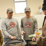 Justin Sheely | The Sheridan Press Sheridan High School football team members Dillon Shaw, left, and Tyler Holloway serve a guest in the community soup kitchen Friday at First Congregational ...