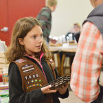 Justin Sheely | The Sheridan Press Junior Girl Scout Sydney Herrigel, 9, offers sample chocolates to guests during the Mountain Craft Bazaar Saturday at the Ranchester Municipal Building.