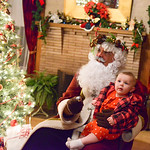 Justin Sheely | The Sheridan Press Father Christmas holds 9-month-old Victoria Gaball during the Holiday Open House at the Trail End State Historic Site Friday evening. Festivities at site,  ...
