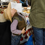 Justin Sheely | The Sheridan Press Three-year-old JP Reinholz stretches his back as his family browses during the Mountain Craft Bazaar Saturday at the Ranchester Municipal Building.