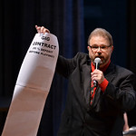 Justin Sheely | The Sheridan Press Dr. Eric Richards, Director of Bands and Jazz Studies, pulls out some items from his bag as he introduces the next song during the Sheridan College Jazz En ...
