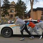 Justin Sheely | The Sheridan Press The Sheridan Broncs wrestling team push a Sheridan Police Department cruiser up the hill past the Sheridan County Courthouse Saturday morning to kickoff pr ...