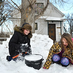 Justin Sheely | The Sheridan Press Twelve-year-old Blaise Chivers, left, and Gracie Blakeman, 8, packs snow bricks as they build a snow fort with Blaine Blakeman Wednesday on Wyoming Avenue. ...