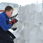 Justin Sheely | The Sheridan Press Eleven-year-old Blaine Blakeman packs snow bricks as he and his friend build a snow fort at his home Wednesday on Wyoming Avenue. The children's plans we ...