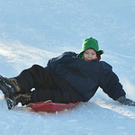 Justin Sheely | The Sheridan Press Twelve-year-old Andrew Hier slides down the slopes on Linden Hill Wednesday morning. Linden Hill is a popular sledding spot located at the end of S. Jeffer ...