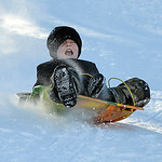 Justin Sheely | The Sheridan Press Eight-year-old Garrett Sorenson slides down the snow Wednesday morning on Linden Hill. Linden Hill is a popular sledding spot located at the end of S. Jeff ...