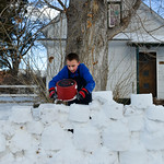 Justin Sheely | The Sheridan Press Eleven-year-old Blaine Blakeman uses a cooking pot to pack snow bricks as he and his friend build a snow fort at his home Wednesday on Wyoming Avenue. The  ...