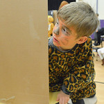 Justin Sheely | The Sheridan Press First-grader James Weaver, as a leopard, looks behind his display board during the Animal Wax Museum Wednesday at Woodland Park Elementary School. Each stu ...