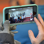 Justin Sheely | The Sheridan Press A parent records video on a cellphone during the Kids Chorus program Thursday at the YMCA. The program is offered for kids Kindergarten through third grade ...