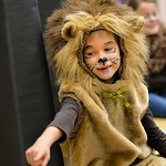 Justin Sheely | The Sheridan Press First-grader Constance Merriam, as a lion, answers questions from a visitor during the Animal Wax Museum Wednesday at Woodland Park Elementary School. Each ...