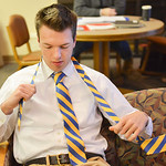 Justin Sheely | The Sheridan Press Garrett Perkins ties a necktie for a teammate during the We the People rehearsal Tuesday at the Sheridan County Fulmer Public Library. Students from Sherid ...