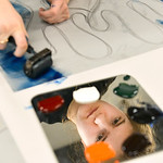 Justin Sheely | The Sheridan Press Buffalo High School junior Isolina Nimick rolls out ink on her template during a printmaking workshop led by renowned artist Theodore Waddell Wednesday in  ...