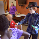 "Justin Sheely | The Sheridan Press Fourth-grader Riley Rankin passes out supplies to classmates during a ""Backyard Ballistics"" class with the homeschool co-op Tuesday morning at Sheridan ..."
