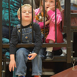 Justin Sheely | The Sheridan Press Four-year-old Noah Watson, left, and Madison Thom, 7, hangout on the bleachers during the boys basketball game against Moorcroft Saturday at Big Horn High  ...