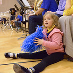 Justin Sheely | The Sheridan Press Four-year-old Evelyn Mullinax plays with pom poms during the Broncs basketball game Friday at Sheridan High School.