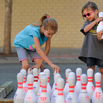 Justin Sheely | The Sheridan Press Nine-year-old Shaelin Fitzgerald, left, and sister Aspen Fitzgerald, 5, set up bowling pins to promote youth bowling leagues during the Third Thursday stre ...