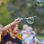 Justin Sheely | The Sheridan Press Ten-year-old Cleo Victor, visiting from France, makesh bubbles during Concerts in the Park Tuesday evening at Kendrick Park. Concerts in the Park are held  ...