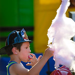 Justin Sheely | The Sheridan Press Six-year-old Dyllan Benavidez licks his fingers of cotton candy during the Third Thursday street festival on Main Street.