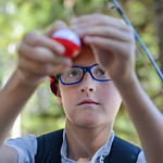 Justin Sheely | The Sheridan Press Twelve-year-old Luke Haukap ties a bobbin to his line during the Sheridan Recreation District's fishing youth program Wednesday at Sibley Lake in the Big ...