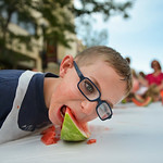 Justin Sheely | The Sheridan Press Seven-year-old Brandon Graham digs into his slice for a watermelon eating contest during the Third Thursday street festival on Main Street. Graham won the  ...