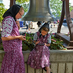 Justin Sheely | The Sheridan Press Seventeen-year-old Joyce Walter, left, and sister Ariana Walter, 9, of the 40-Mile Colony near Lodge Grass, Montana, wait to ring the bell during the Famer ...