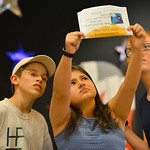 "Justin Sheely | The Sheridan Press Amaya Cook holds up a mysterious telegram addressed to Mr Witherspoon as Camden Schroth, left, and Claire Schnatterbeck looks on during a rehearsal for "" ..."