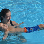 Justin Sheely | The Sheridan Press  Tongue River High School junior Jenna Keller holds Lute Paulsen, 5, as he learns to float on his back during swimming lessons Thursday at the public pool  ...