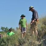 Justin Sheely | The Sheridan Press Eleven-year-old Coye Gregory follows geology expert Doug Melius up a hill in search for petrified wood during Science Kids' Rock Talk Wednesday at the We ...
