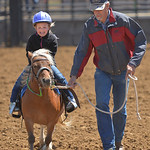 Justin Sheely | The Sheridan Press Gary Mefford leads his three-year-old daughter Londyn Mefford on a pony for barrel racing during the Young Riders Rodeo Saturday at the Sheridan County Fai ...