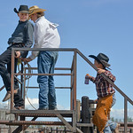 Justin Sheely | The Sheridan Press Will Albrecht, left, and Zane Huntley hang out as Royce Nelson climbs the stairs to the platform during the Young Riders Rodeo Saturday at the Sheridan Cou ...