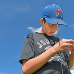 Justin Sheely | The Sheridan Press Thirteen-year-old Cade Butler replaces a lure on his younger brother's line at Sam Mavrakis Pond on Wednesday. The popular fishing pond is located off W. ...