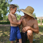 "Justin Sheely | The Sheridan Press Five-year-old Henry Szewc pulls on the hat string from his dad Jason Szewc during the ""Good Ole Fashioned Hoe-Down"" Saturday at the Quarterman place no ..."