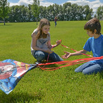 Justin Sheely | The Sheridan Press Thirteen-year-old Amanda Maronick, left, and Brayden Gilbert, 11, untangle the line from the tail of their kite Saturday at Sagebrush Elementary School.