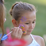 Justin Sheely | The Sheridan Press Eight-year-old Makayla Warren Warren receives a face painting at the Tongue River Child's Place fundraiser barbeque Wednesday at Scott Park in Dayton. Th ...