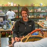 Justin Sheely | The Sheridan Press Kim Lassiter makes a purchase during the grand opening Friday at Verdello on Grinnell Plaza. The store offers a variety of oils, sauces, vinegars and other ...