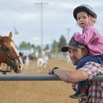 Justin Sheely | The Sheridan Press Three-year-old Brett Taylor gets a ride from Peter Taylor prior to the events at the Sheridan Cowgirls Association Rodeo Thursday at the Sheridan County Fa ...