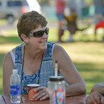 Justin Sheely | The Sheridan Press Deb Hofmeier visits with friends at the Tongue River Child's Place fundraiser barbeque Wednesday at Scott Park in Dayton. The dinner was an opportunity f ...